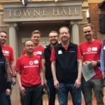 Bank of America Financial Volunteers stand together in Front of Town Hall in Young AmeriTowne